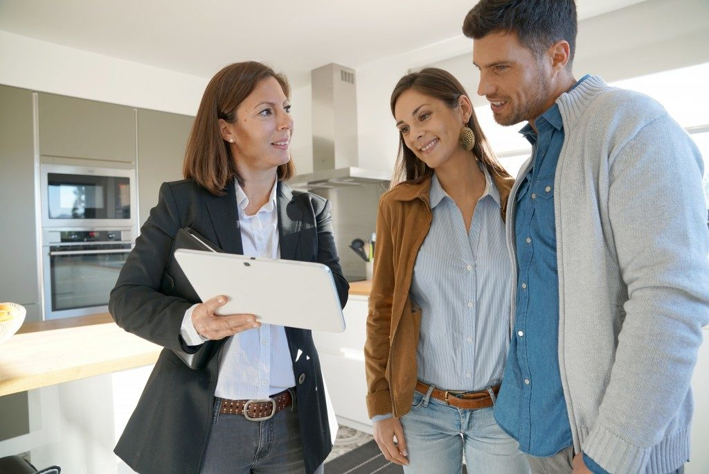 agent showing house to couple