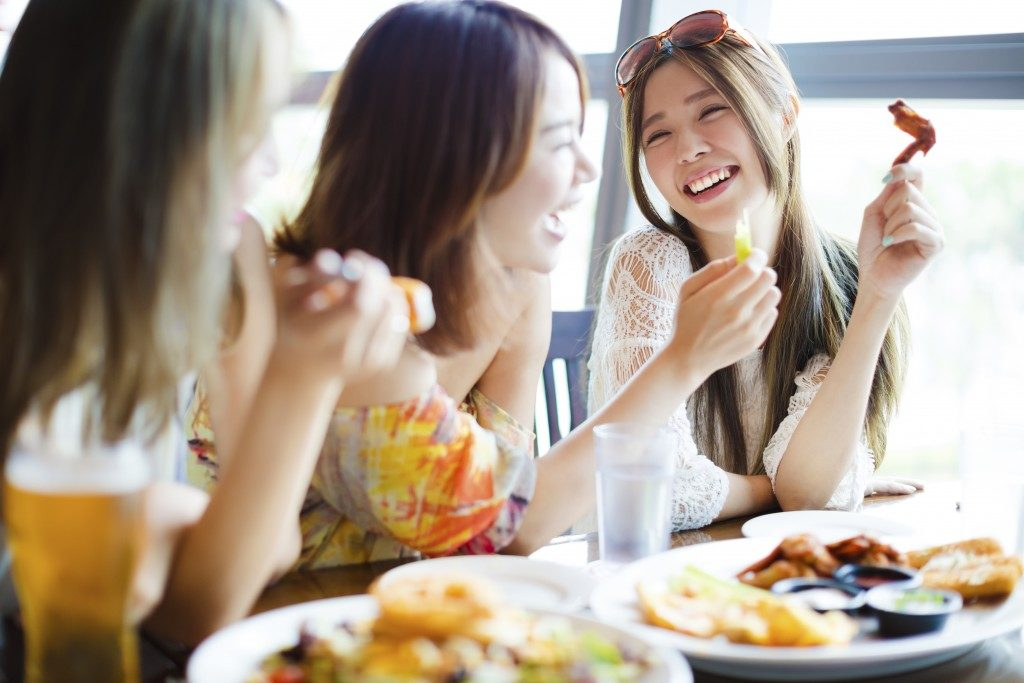 Friends enjoying meal at the restaurant