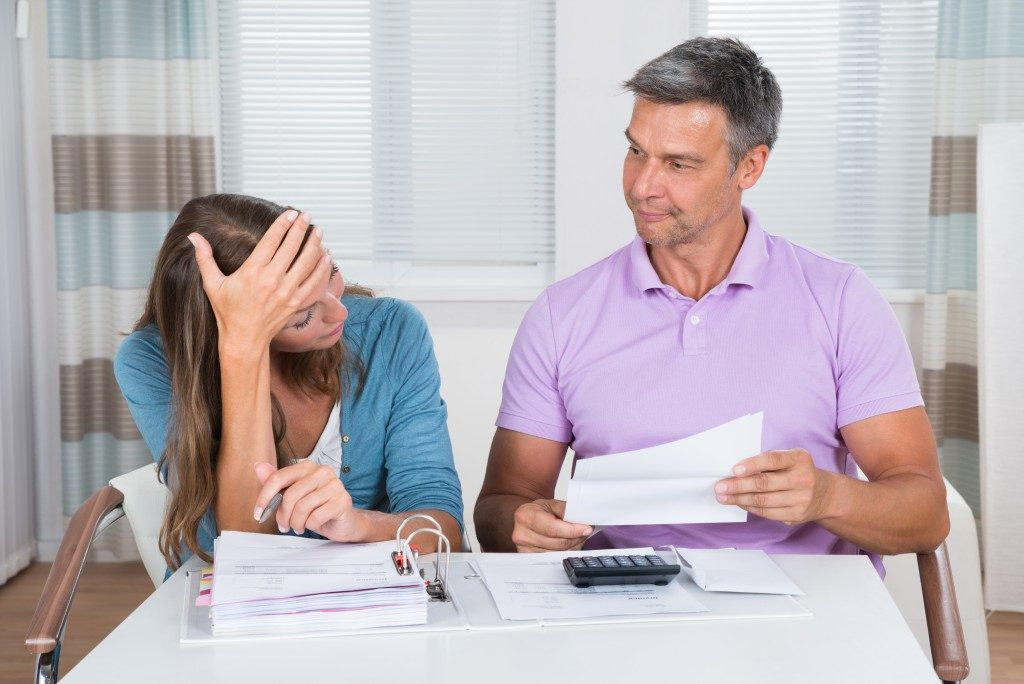 problematic couple looking at documents