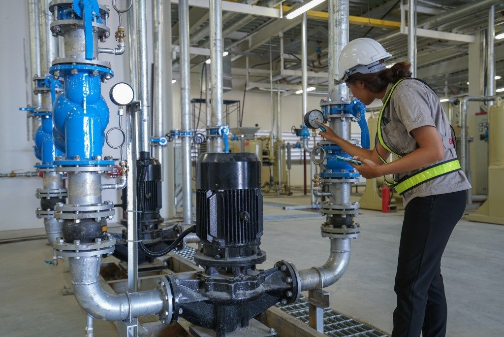 woman working on dosing pump