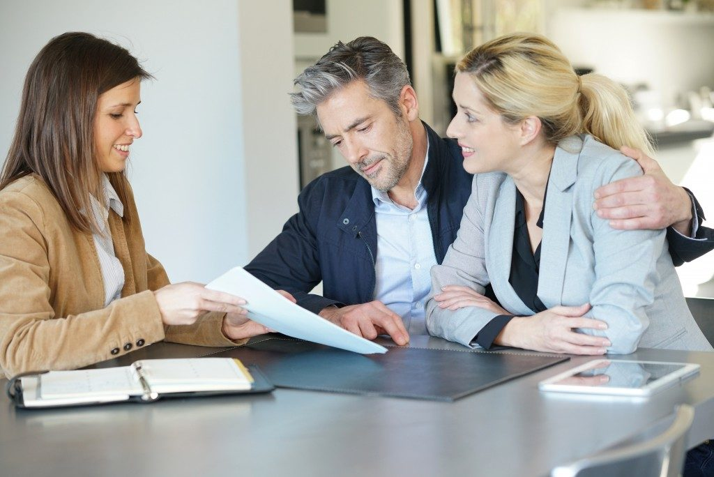 Couple consulting real estate agent