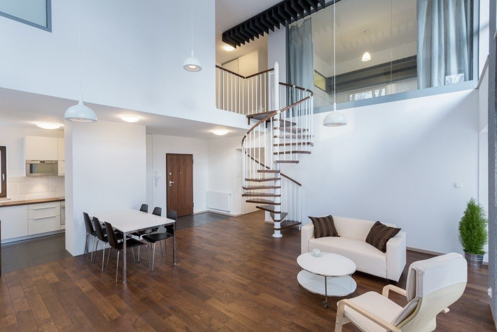 spacious living room with spiral staircase