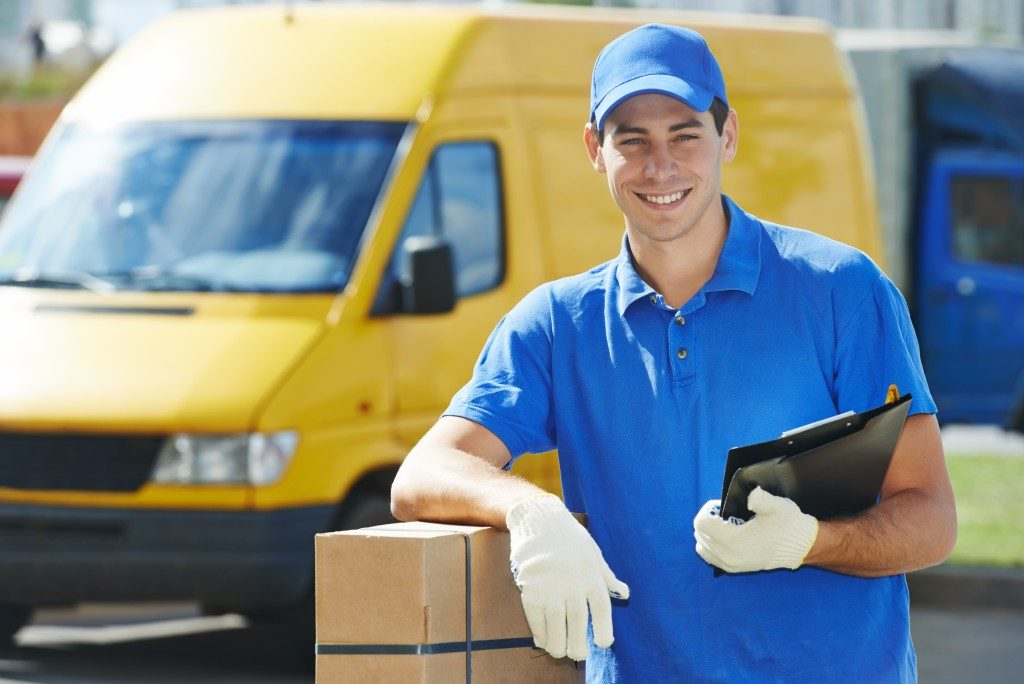 man working for shipping company is smiling