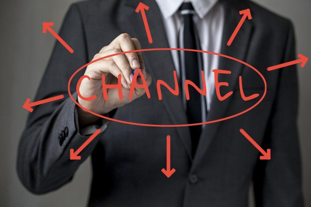 "Businessman writing ""channel"""