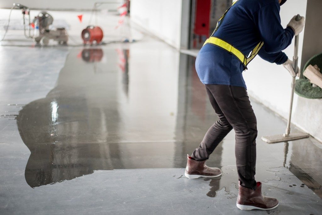 cleaning concrete floors of a building