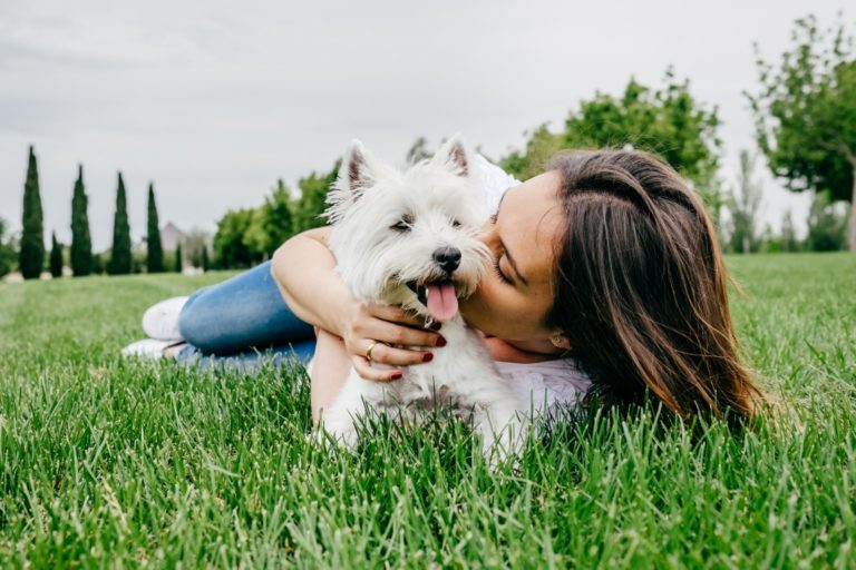 woman with her white dog