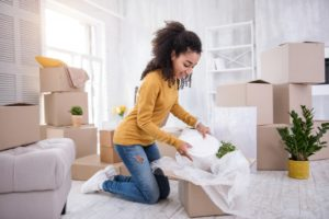 young girl unpacking her things