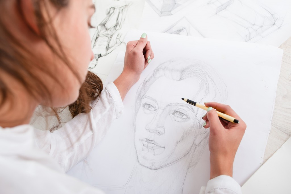 artist drawing portrait