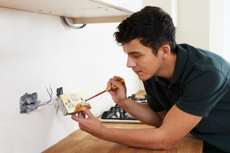 Man fixing the electrical outlet
