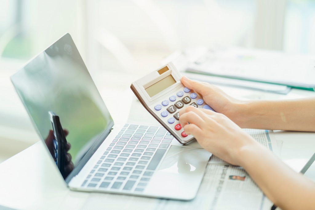 calculator infront of laptop