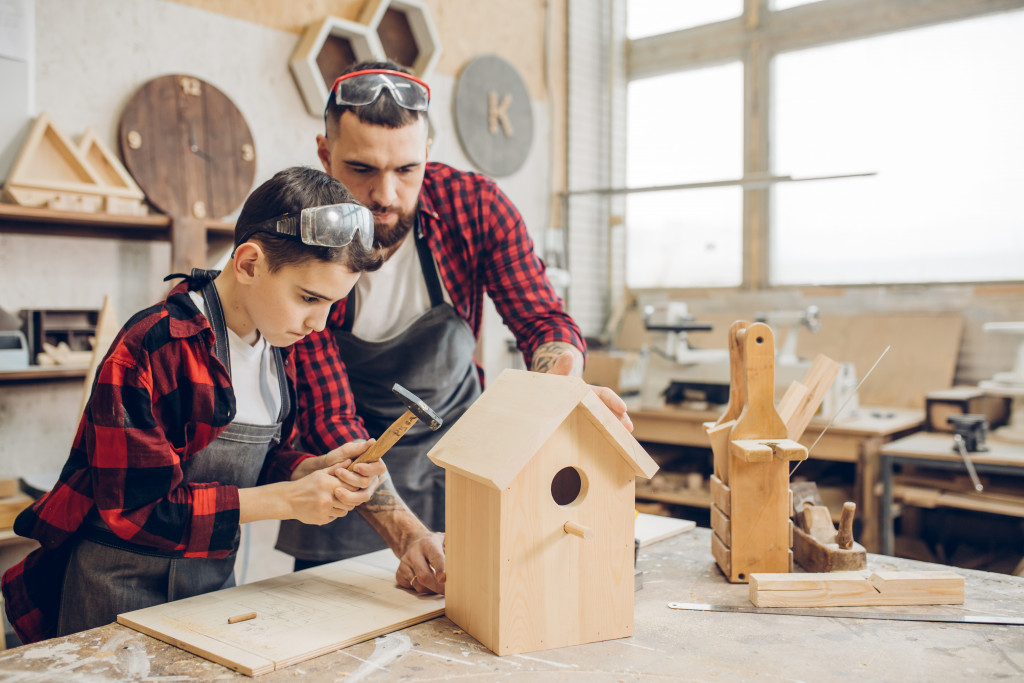 father and son woodwork workshop