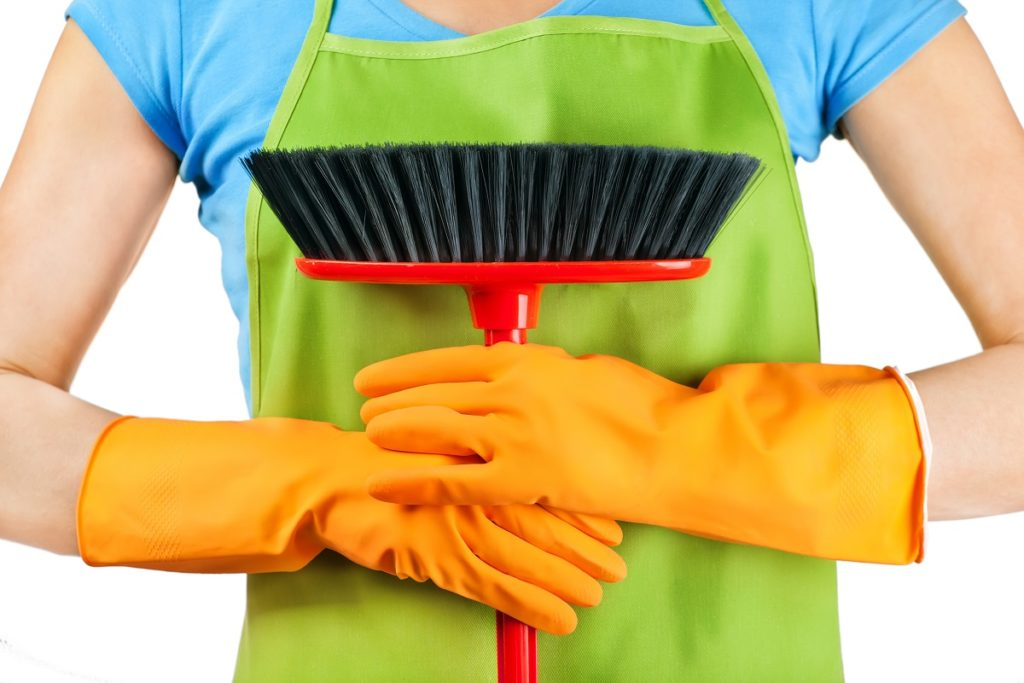 person holding a broom