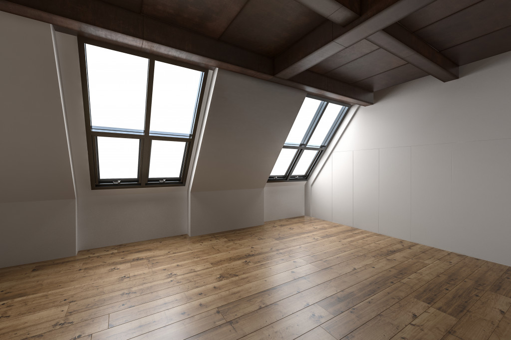 attic with hardwood floor