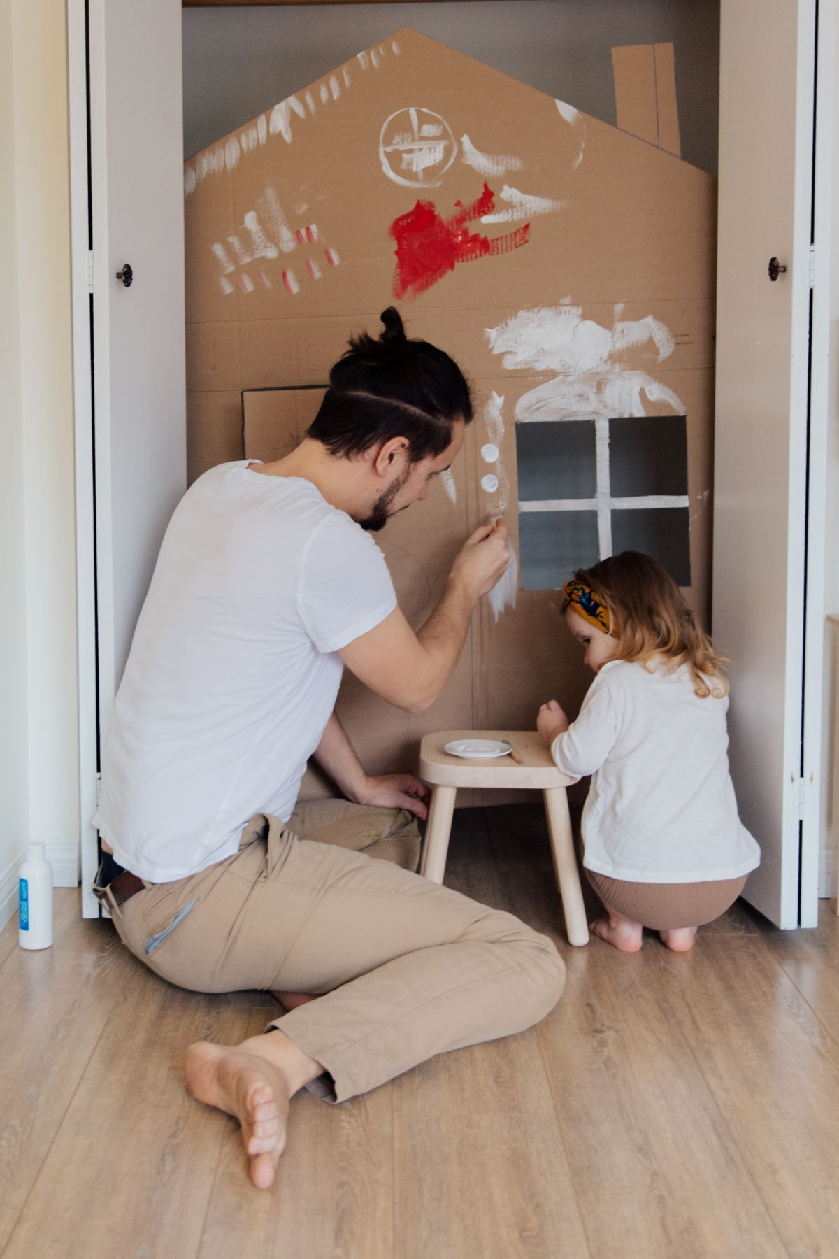 man and daughter playing together