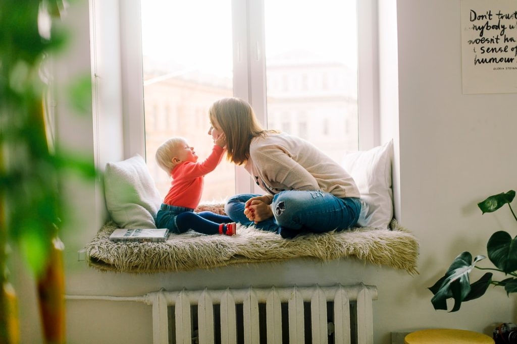 child playing with mom