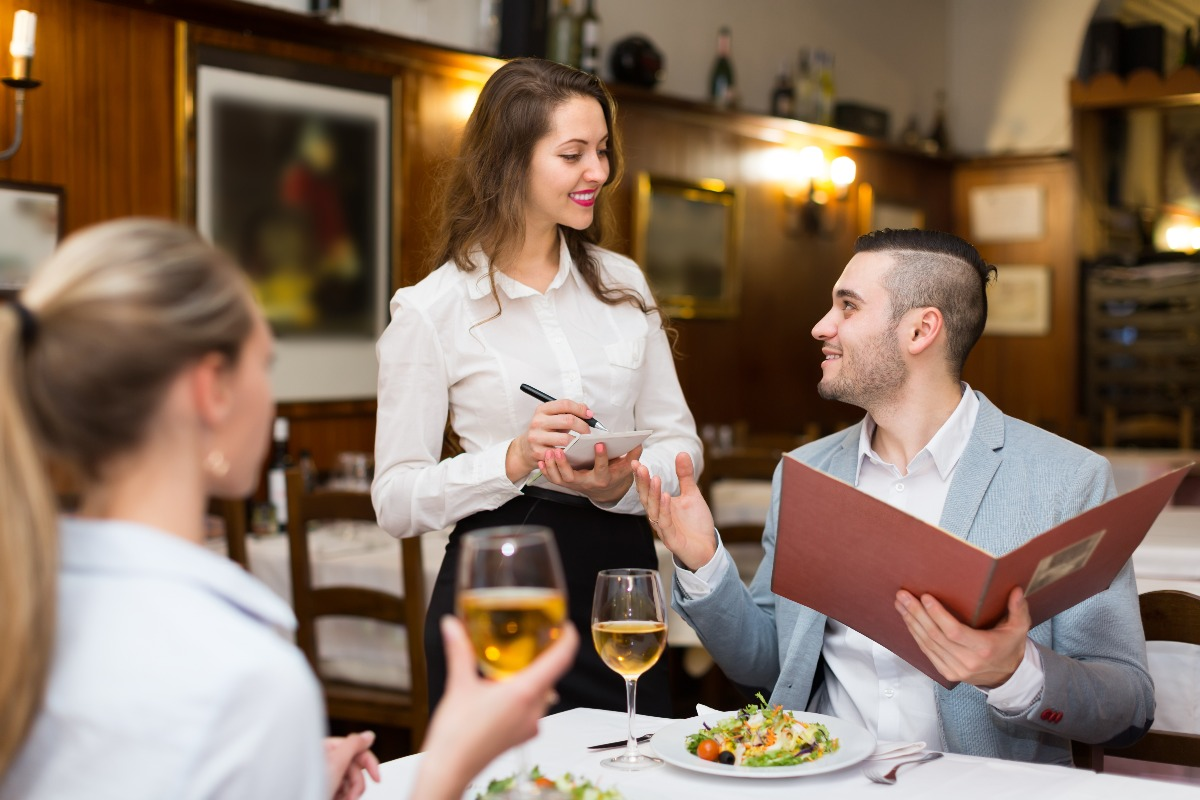 restaurant customers with a waitress