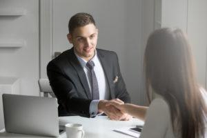 interviewer congratulating an employee